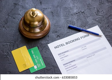hotel reservation blank and ring on dark background