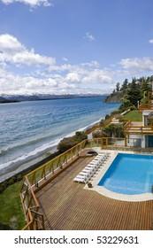 Hotel resort pool by the lake shore. Nahuel Huapi lake. Patagonia. Argentina