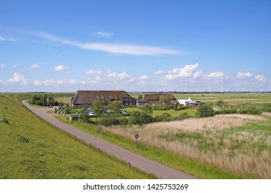 Hotel Road rbehind the dikes and the Wadden Sea Hattstedtermarsch in the district of Nordfriesland, in Schleswig-Holstein, Germany