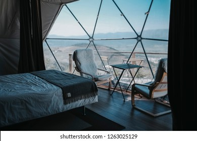 hotel room in a design montain chalet. Also known as glamping - camping with glamour