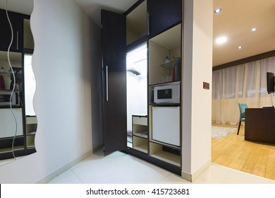 Hotel room interior with mini bar and safe box