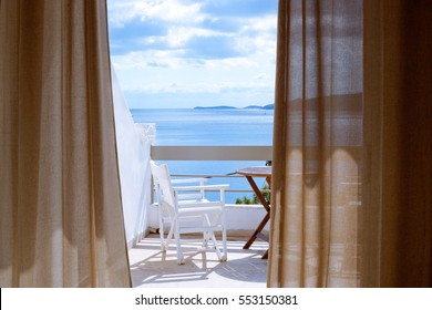 Hotel room with a sea view house near the sea in the environmental and green location on the island. The window overlooking the ocean. The endless expanse of the sea. Place for a romantic holiday.