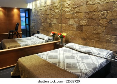 Hotel room with stone textured walls