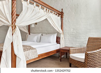 Hotel room - vacation concept background - Luxurious modern bedroom interior with canopy bed