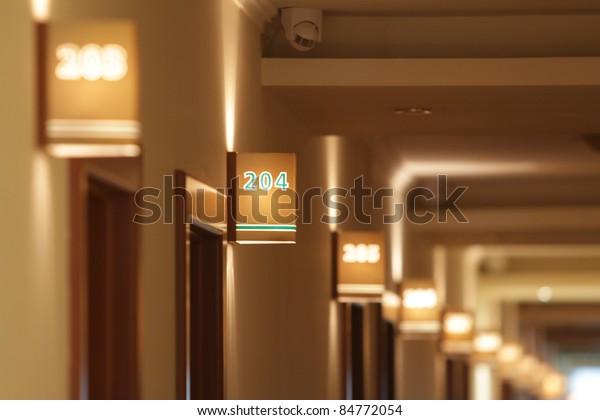 Hotel Rooms focused on one room number