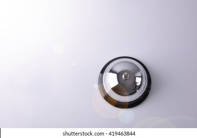 Hotel service bell on a table white glass. Concept hotel, travel, room. Top view