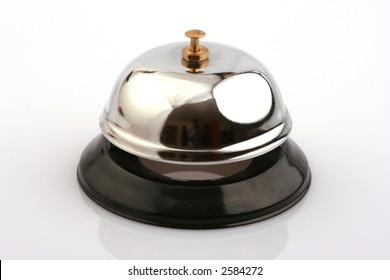 A hotel or service bell shining silver with a black base on a white background