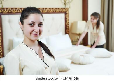 Hotel service. female housekeeping workers at inn room
