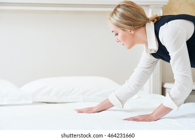Hotel service. Made making bed in room