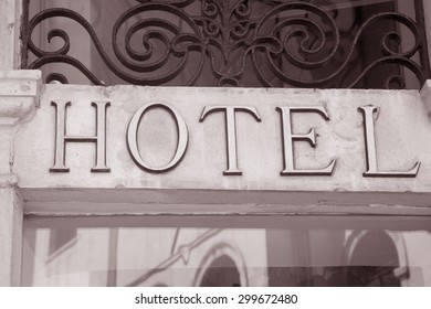 Hotel Sign above Building Entrance in Black and White Sepia Tone
