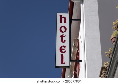 Hotel Sign against Blue Sky Background