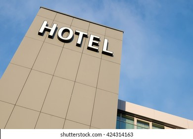 hotel sign against blue sky