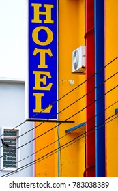 hotel sign on yellow building