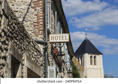 Hotel sign over building entrance in old european town