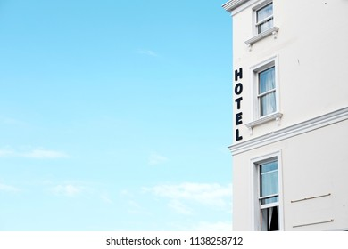 Hotel signage against a blue sky.
