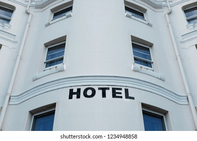 Hotel signage on a building wall.