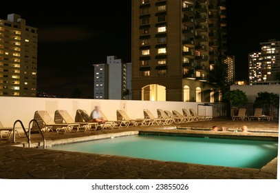 Hotel with swimming pool late at night.