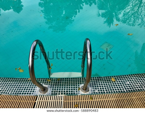 Hotel swimming pool with sunny reflection