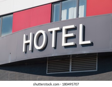Hotel word in the facade of a Hotel outdoors