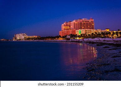 Hotels along the Gulf of Mexico at night in Clearwater Beach, Florida.