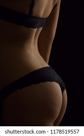 hoto of a female figure on a black background