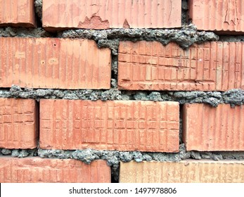 hoto texture of masonry brick red color for the design of different backgrounds
