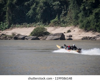 HOUAY XAI, LAOS - JANUARY 20, 2018: People drive along the river Mekong by speedboat frm Houay xai to Luang Prabang, Laos.