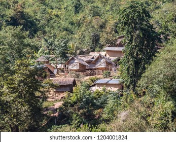 Houay Xai, Laos - January 20, 2018: A small village in the steep mountains at the side of the river Mekong near Houay Xai, Laos.