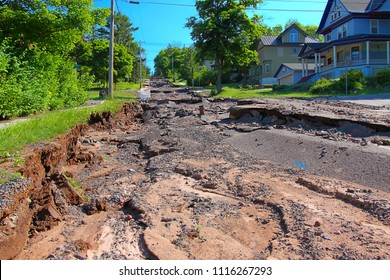 HOUGHTON, MICHIGAN - JUNE 18 2018: Intense storm rainfall and flash flooding in June of 2018 caused property damage and completely washed out Agate Street in the town of Houghton, Michigan.