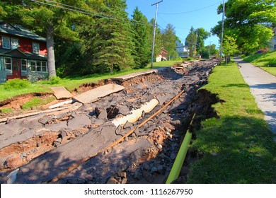 HOUGHTON, MICHIGAN - JUNE 18 2018: Intense storm rainfall and flash flooding in mid-June of 2018 caused damage to roads, sidewalks, and bridges and completely washed out Agate Street in Houghton, MI.