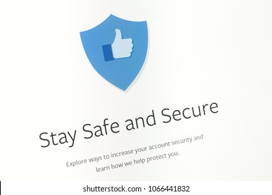 """Houilles, France - April 10, 2018:Closeup of the word """"Stay Safe and Secure"""" with an blue icon above of the Facebook website."""