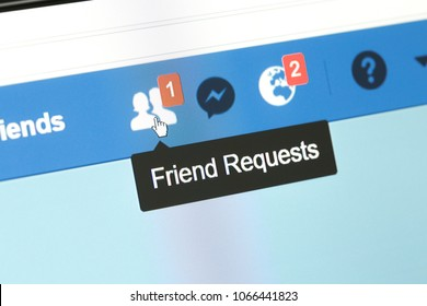 """Houilles, France - April 10, 2018:Facebook web page closeup with notifications icons of new friend swith a tooltip displaying """"Friend requests"""" and actuality too."""