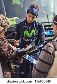 HOUILLES,FRANCE-MARCH 3:The Spanish cyclist Jesus Herrada from Movistar team signs autograph to fans before taking the start in the prologue of the race Paris- Nice 2013 in Houilles on March 3rd 2013