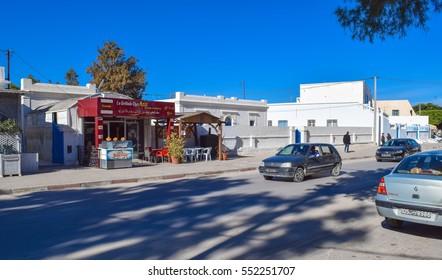 HOUMT EL SOUK/DJERBA/TUNISIA - JANUARY 3 2017: Streets and buildings of Houmt El Souk town in Tunisia. Djerba island. Northern Africa