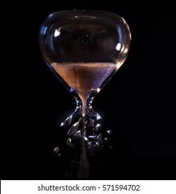 An hour glass with a broken bottom