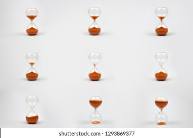 Hourglass isolated on white background. Different time on the hourglass. 3d rendering illustration of sandglass. Set on a white background.