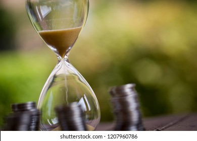 Hourglass and money wealth, time accumulation, time is money