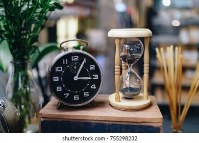 Hourglass and old vintage clock, Sand clock