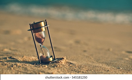 Hourglass on the beach dunes. (vintage style)