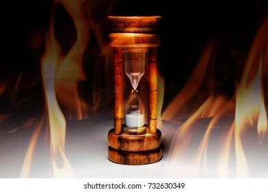 Hourglass on black background, spot lighting, black and white image