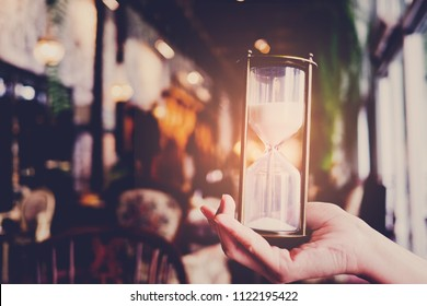 hourglass, hourglass on hand, time countdown, clock with sand