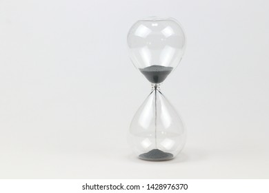 Hourglass on white background. - Image
