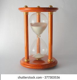Hourglass on White Background with Sand Falling Moving to show Time