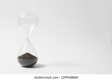 Hourglass On White Background Showing Time's Up, Countdown Is Over,The End