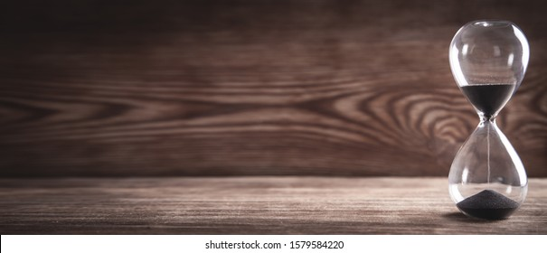 Hourglass on wooden table. Time, Business