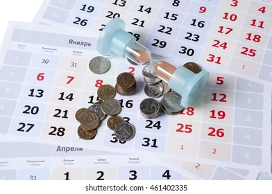 Hourglass and rubles scattered on calendar sheets