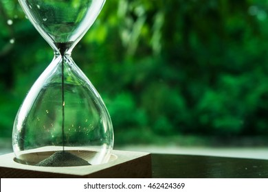 Hourglass or Sandglass counting down deadline time with patience