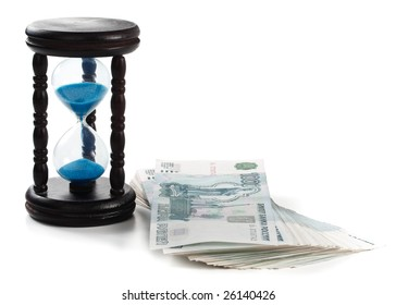 Hourglass standing on a floor from banknotes. Concept for time is money.