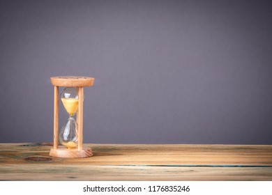 Hourglass as time passing, business deadline and free copy space. marketing, advertising and successful reviews concept