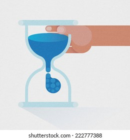 Hourglass timer by hand business concept